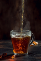 Black tea pouring into glass cup with natural steam - PhotoDune Item for Sale