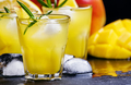 mango rum collins, with syrup, lemon juice, ginger ale and ice - PhotoDune Item for Sale