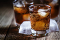 Alcoholic cocktail bourbon cola with whiskey and ice cubes - PhotoDune Item for Sale