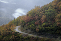Mountain Road curves across an Autum Forest - PhotoDune Item for Sale