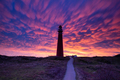 dramatic purple mammatus clouds over red lighthouse - PhotoDune Item for Sale