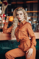 Nice fashion model holding fruit in cafe - PhotoDune Item for Sale