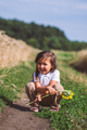 A little cute girl jumping in the field in summer morning - PhotoDune Item for Sale