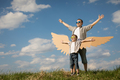 Father and son playing with cardboard toy wings - PhotoDune Item for Sale