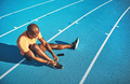 Young athlete tying his shoes before for a track run - PhotoDune Item for Sale