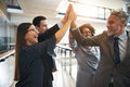Business team high fiving each other in an office - PhotoDune Item for Sale