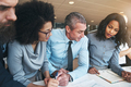 Diverse work colleagues talking business together in a modern office - PhotoDune Item for Sale