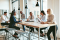 Diverse group of businesspeople talking together around an office table - PhotoDune Item for Sale