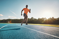 Young African athlete sprinting down a running track - PhotoDune Item for Sale