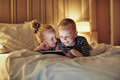 Laughing little brother and sister watching videos before bedtime - PhotoDune Item for Sale