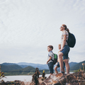 Happy family standing near the lake at the day time. - PhotoDune Item for Sale