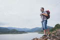 Happy man standing near the lake at the day time. - PhotoDune Item for Sale