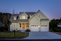 Front elevation of beautiful home lit up at twilight. - PhotoDune Item for Sale