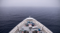 Bow of ship moving through heavy fog, with motion blur on waves. - PhotoDune Item for Sale