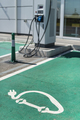 Electric charge station. Electric plug for charging cars. Car charging symbol painted on asphalt. - PhotoDune Item for Sale