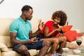 Black African American couple having fun playing video games - PhotoDune Item for Sale