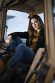A farm girl sitting in the Tractor - PhotoDune Item for Sale