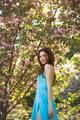Woman at Blossoming Sakura Tree on Nature - PhotoDune Item for Sale