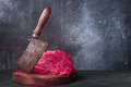 Raw beef and meat cleaver on chopping deck - PhotoDune Item for Sale