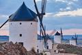 Traditional antique windmills at sunset in Spain. Consuegra, Toledo. Travel - PhotoDune Item for Sale