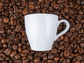 Cup of coffee on coffee beans - PhotoDune Item for Sale