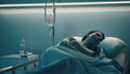 Woman lying in the hospital bed and sleeping with IV drip - PhotoDune Item for Sale