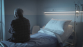 Sad lonely senior sitting in a hospital bed - PhotoDune Item for Sale