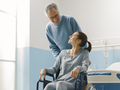 Father assisting her daughter in wheelchair - PhotoDune Item for Sale