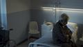 Depressed senior sitting on the hospital bed alone - PhotoDune Item for Sale