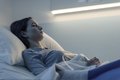 Young woman lying in a hospital bed at night - PhotoDune Item for Sale