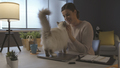 Woman sitting at desk and cuddling her cat - PhotoDune Item for Sale