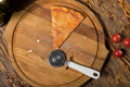 Slice of pizza, tomatoes, cheese, olive oil on a wooden table - PhotoDune Item for Sale