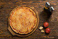 Pizza, tomatoes, cheese, olive oil on a wooden table - PhotoDune Item for Sale