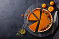 Pumpkin pie on marble cutting board. Dark background. Copy space. Top view. - PhotoDune Item for Sale