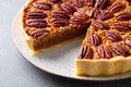 Pecan nut pie, tart on a plate. Grey background. Close up. - PhotoDune Item for Sale