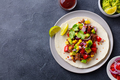 Taco with meat and vegetables. Dark background. Copy space. Top view. - PhotoDune Item for Sale