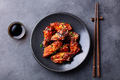Chicken wings. Traditional asian recipe. Dark background. Top view. - PhotoDune Item for Sale