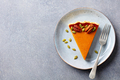 Pumpkin pie, tart on a plate. Grey stone background. Copy space. Top view. - PhotoDune Item for Sale