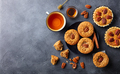Pecan muffins, cakes, pies with cup of tea. Dark background. Top view. Copy space. - PhotoDune Item for Sale