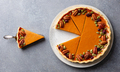 Pumpkin pie on a plate. Grey background. Close up. Top view. - PhotoDune Item for Sale