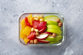Fruits salad and nuts in a glass container. Healthy eating. Grey background. Top view. - PhotoDune Item for Sale