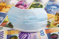 Protective mask on a Swiss money background - PhotoDune Item for Sale
