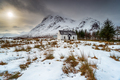 An old mountain cottage under a blanket of snow - PhotoDune Item for Sale