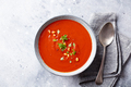 Tomato soup with fresh herbs and pine nuts in a bowl. Grey stone background. Top view. - PhotoDune Item for Sale