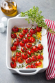 Roasted cherry tomatoes with herbs in baking dish. Grey background. - PhotoDune Item for Sale