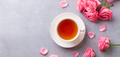 Cup of tea with pink rose. Grey stone background. Top view. Copy space. - PhotoDune Item for Sale