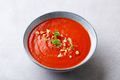 Tomato soup with fresh herbs and pine nuts in a bowl. Grey stone background. Close up. - PhotoDune Item for Sale
