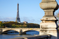Eiffel tower, bridge with Seine river and column in a sunny day in Paris, France - PhotoDune Item for Sale