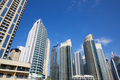 Dubai Marina skyscrapers, low angle view in a sunny day, clear blue sky in Dubai - PhotoDune Item for Sale