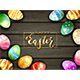 Colored Easter Eggs and Lettering Happy Easter on Black Wooden Background - GraphicRiver Item for Sale